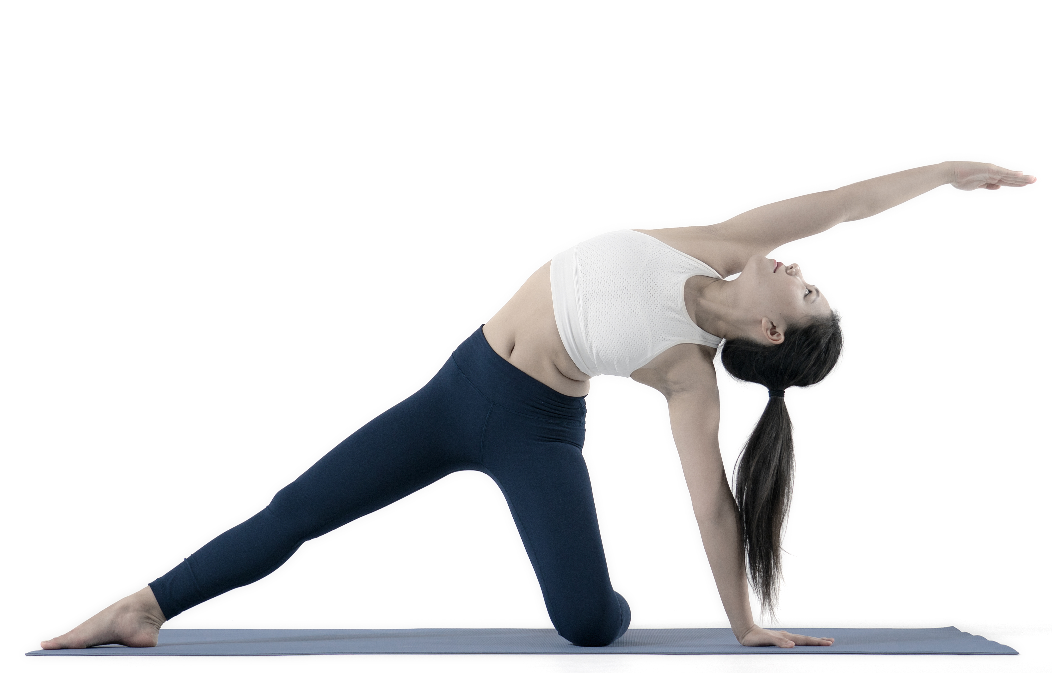 Yoga Nexus model posing gate pose in side stretch